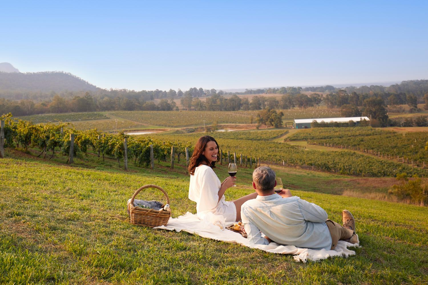 Couple enjoying a picnic at Audrey Wilkinson, Pokolbin in the Hunter Valley